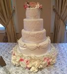 White wedding cake with laces and flowers
