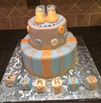 Baby shower cake blue and gold with the booties